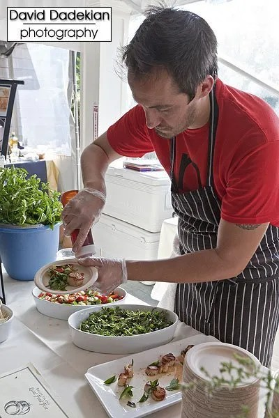 Nick's on Broadway's Chef Derek Wagner preparing Bomster Scallops with a Cucumber-Tomato Salad