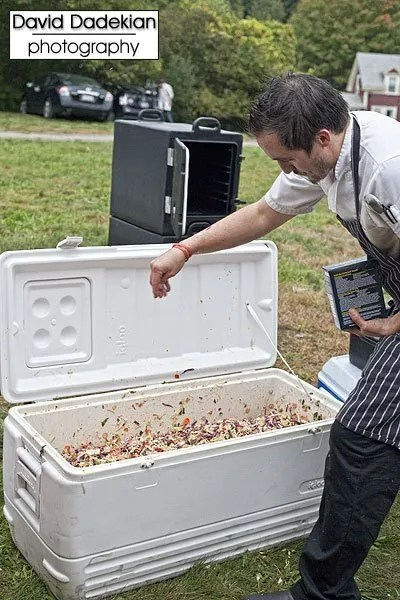 Nick's on Broadway Chef Derek Wagner seasoning a whole ton of cole slaw