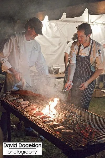 Chef Ed Doyle of RealFood Consulting Inc. and Chef Derek Wagner of Nick's on Broadway barbecuing pig skin