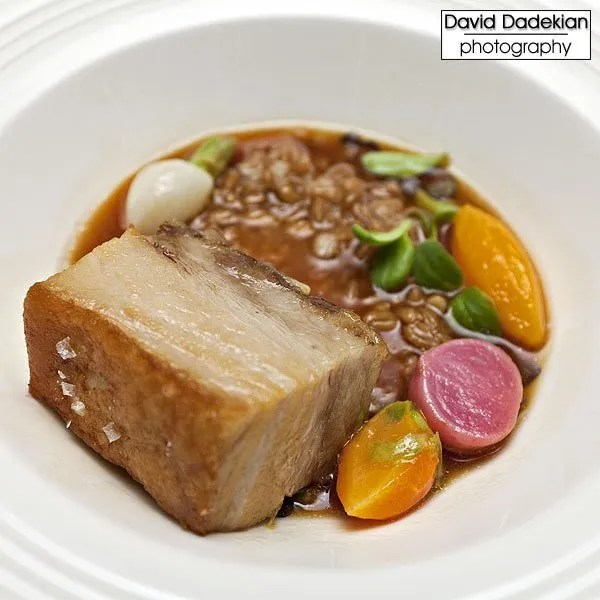 Vermont Pork Belly with Toasted Farro, Native Winter Root Vegetables and Juniper-Scented Consomme