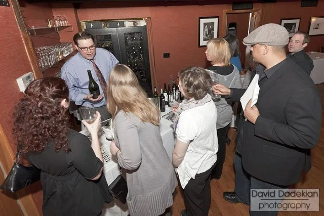 Michael Lester of M.S. Walker pours wine for tasters at Gracie's Winter Wines of the World event