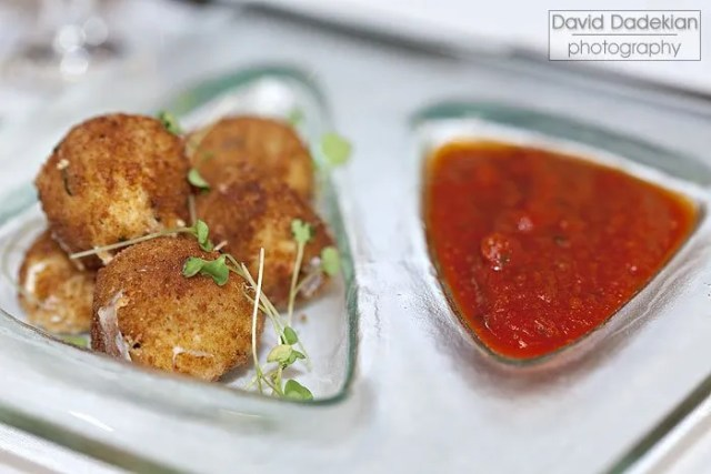 Mozzarella Arancini with San Marzano marinara sauce, micro basil