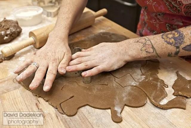 Jordan Goldsmith cutting the rolled dough into men
