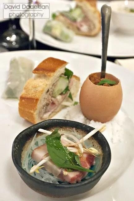 Chef Bissonnette's plate, clockwise from upper left: La Lot Vietnamese Sausage, Bánh Mì, Pig Foot Rillette, Pork Belly Pho