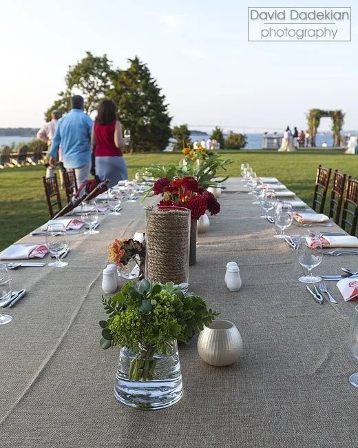 Guests sample hors d'oeuvres on the lawn while watching the clambake pit