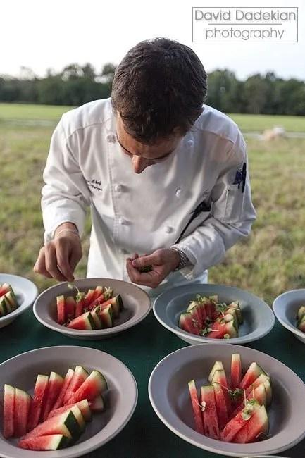 Matthew Varga preparing watermelon