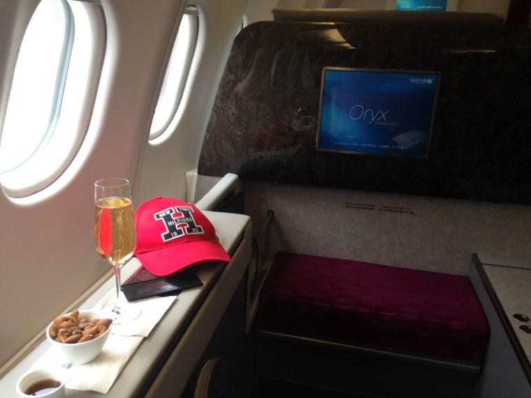 Qatar Airways First Class LHR DOH champagne
