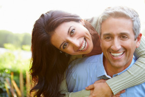 Portrait Of Loving Hispanic Couple In the Countryside