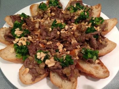 Stir-Fried Marinated Beef over Steamed Baguette