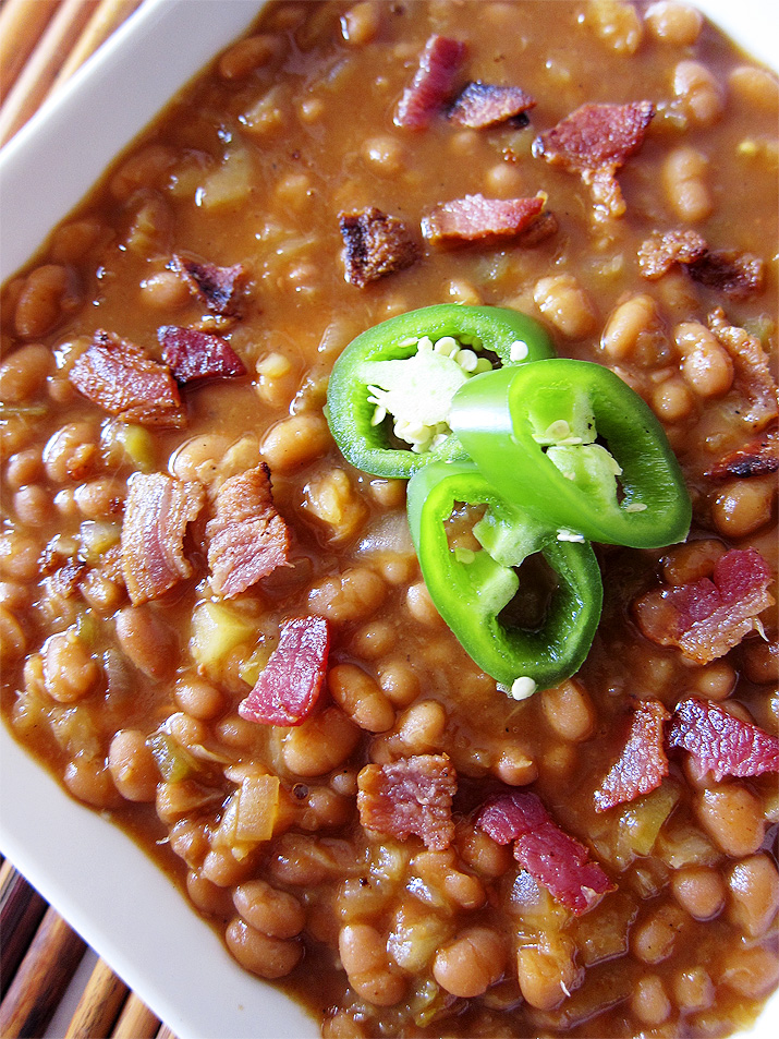 These bakes beans are your ordinary side dish. Crispy bacon, green chiles and pineapple juice add some extra oomph to this traditional dish.