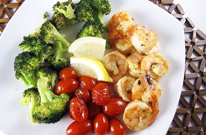 Roasted Shrimp, Tomatoes and Broccoli: A low-carb, good-for-you meal that you can assemble and bake within 30 minutes.