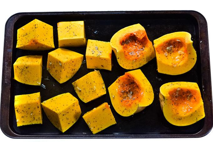 raw butternut squash on tray