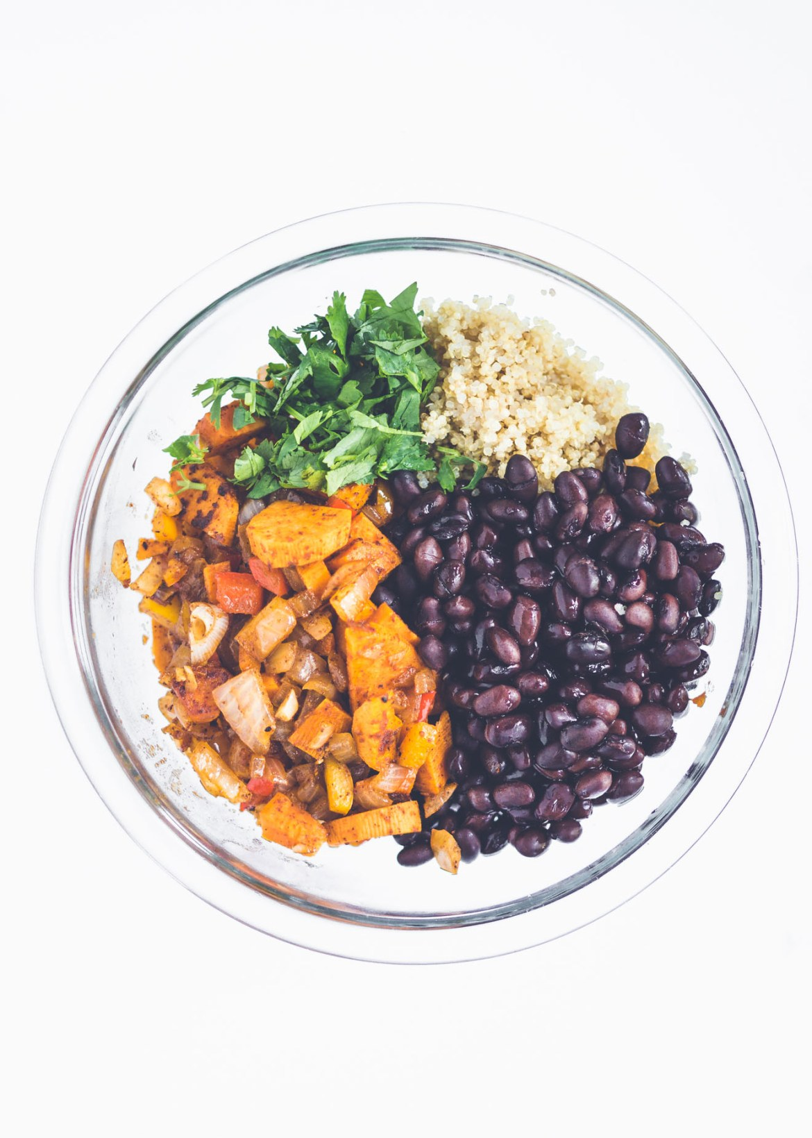 Bowl of cooked sweet potatoes, cilantro, quinoa and black beans