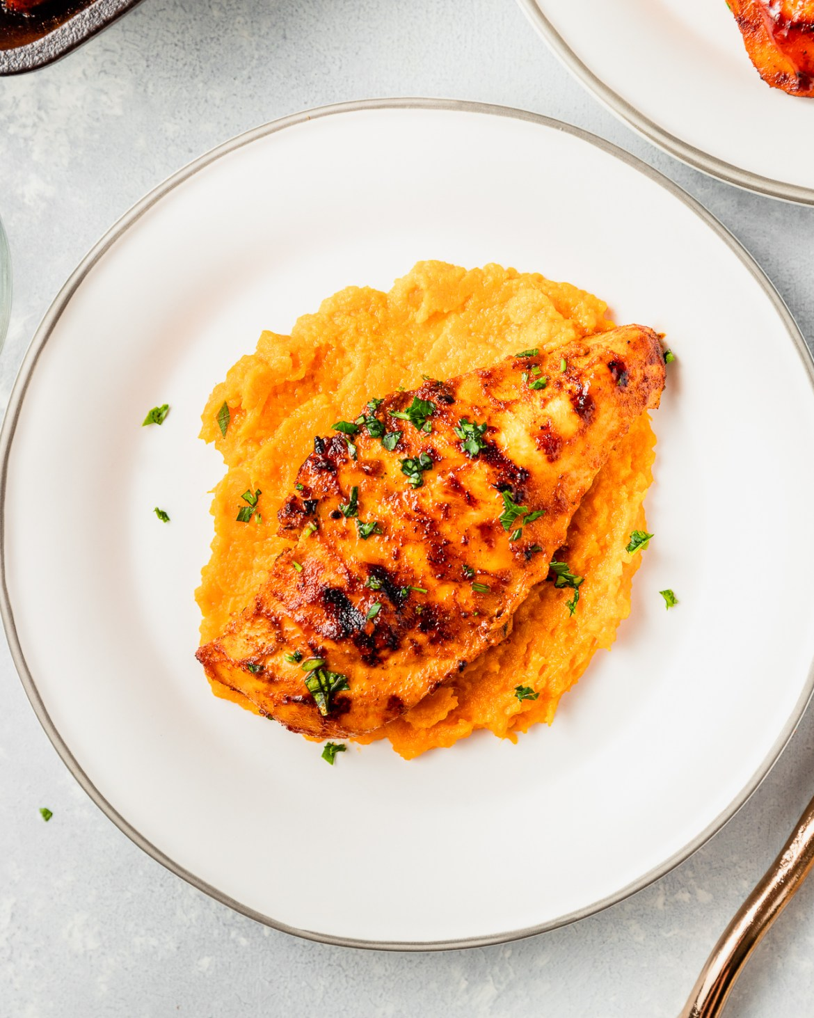 bbq chicken served with mashed sweet potatoes