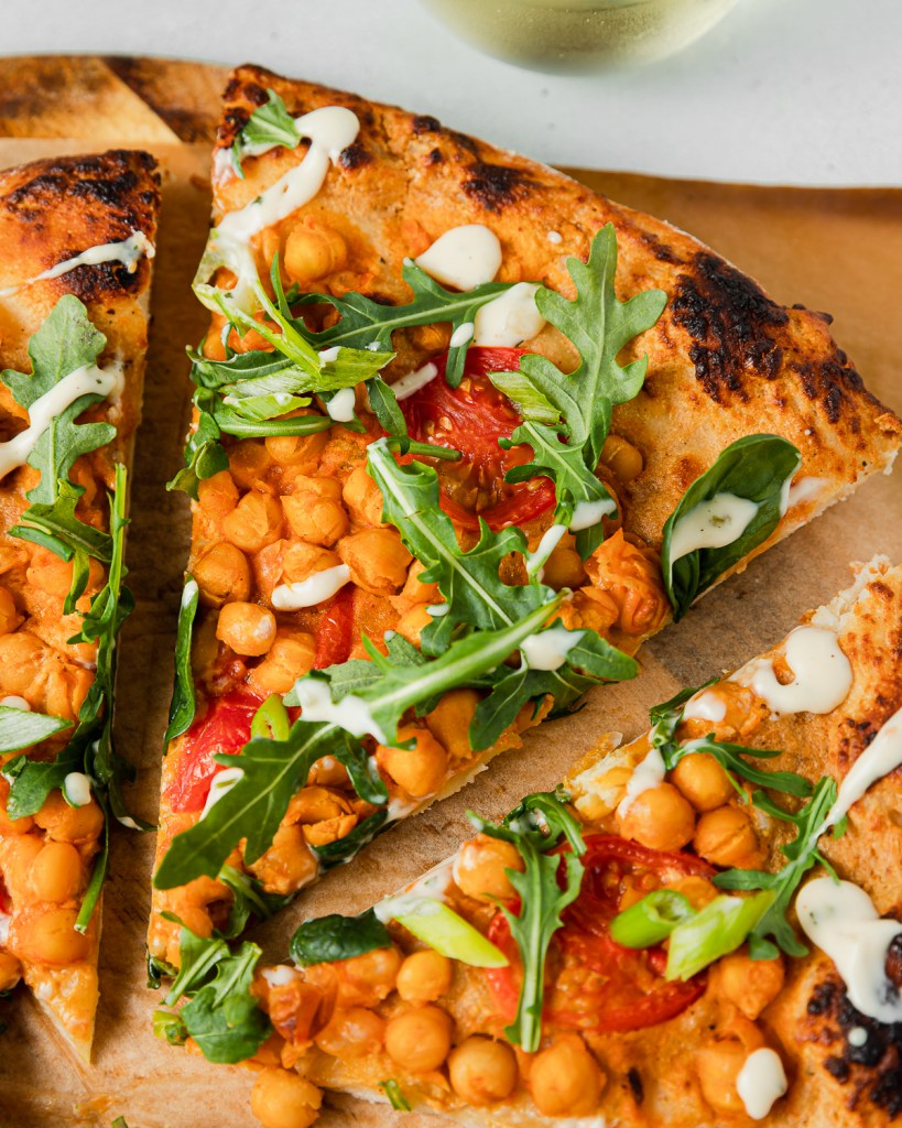 Slice of Pizza with buffalo chickpeas and ranch