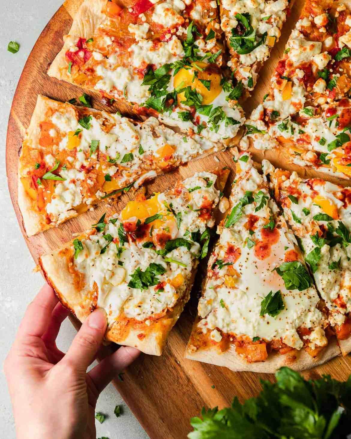 A slice of Shakshuka pizza