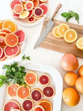 Slices of Citrus Fruit with Knife and Cutting Board