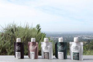 Five SuperFat Single Serve Products over city skyline