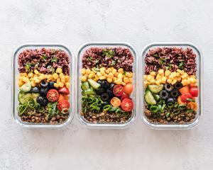 Three Food Containers with Salads