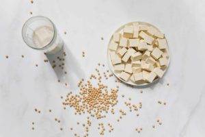Cut Tufo on White Table with Soybeans and Milk