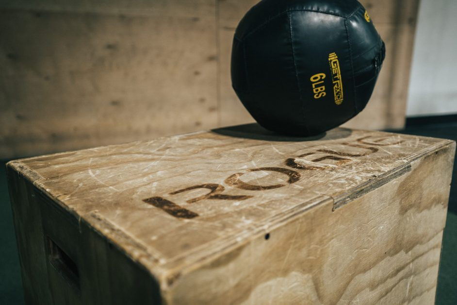Black Medicine Ball on Wooden Box