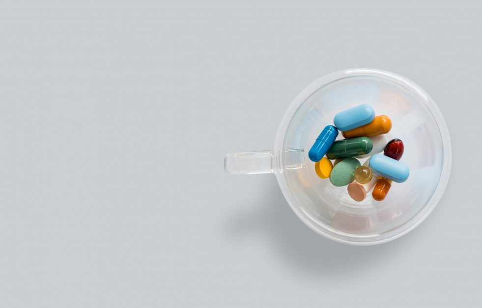Clear Container Holding Multi Color Pills
