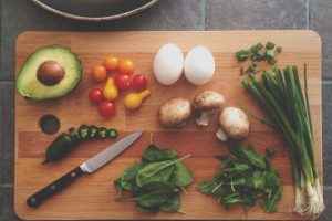 Cutting Board With Knife, Vegetables and Egg