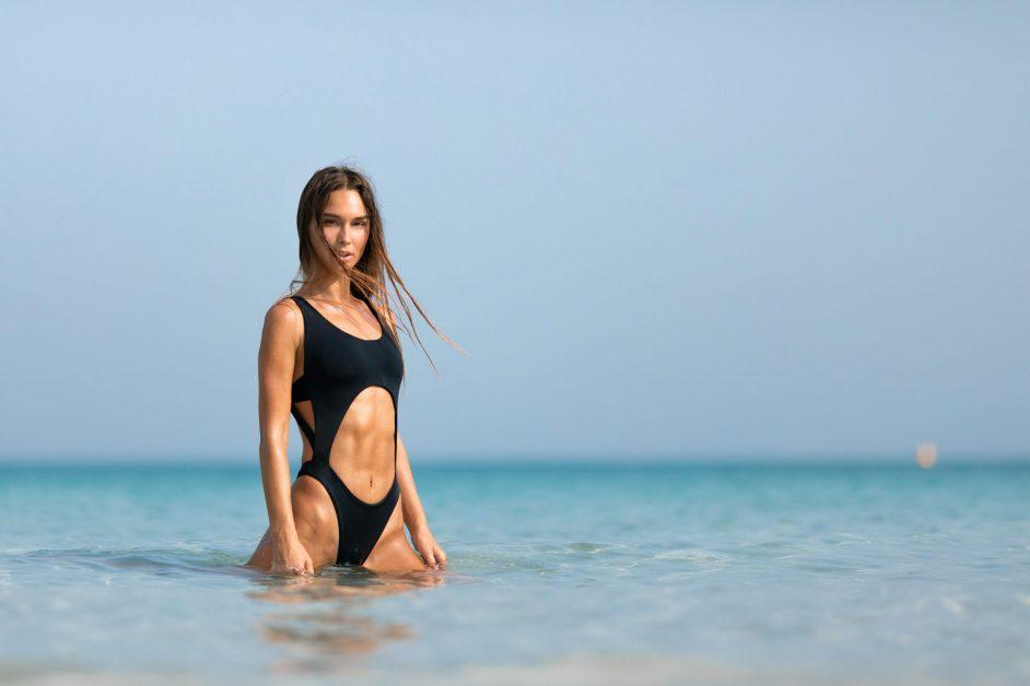 Woman with Toned Abs Wearing Black Monokini in Ocean