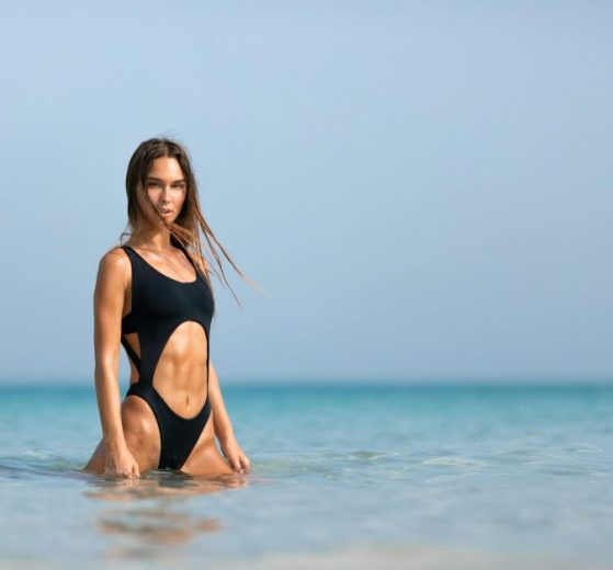 Woman with Toned Abs Wearing Black Monokini in Ocean