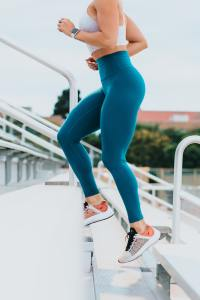 Woman Running up Stairs in Yoga Pants