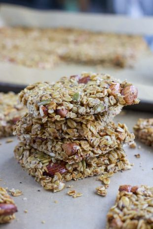 stack of square granola bars filled with oats and nuts