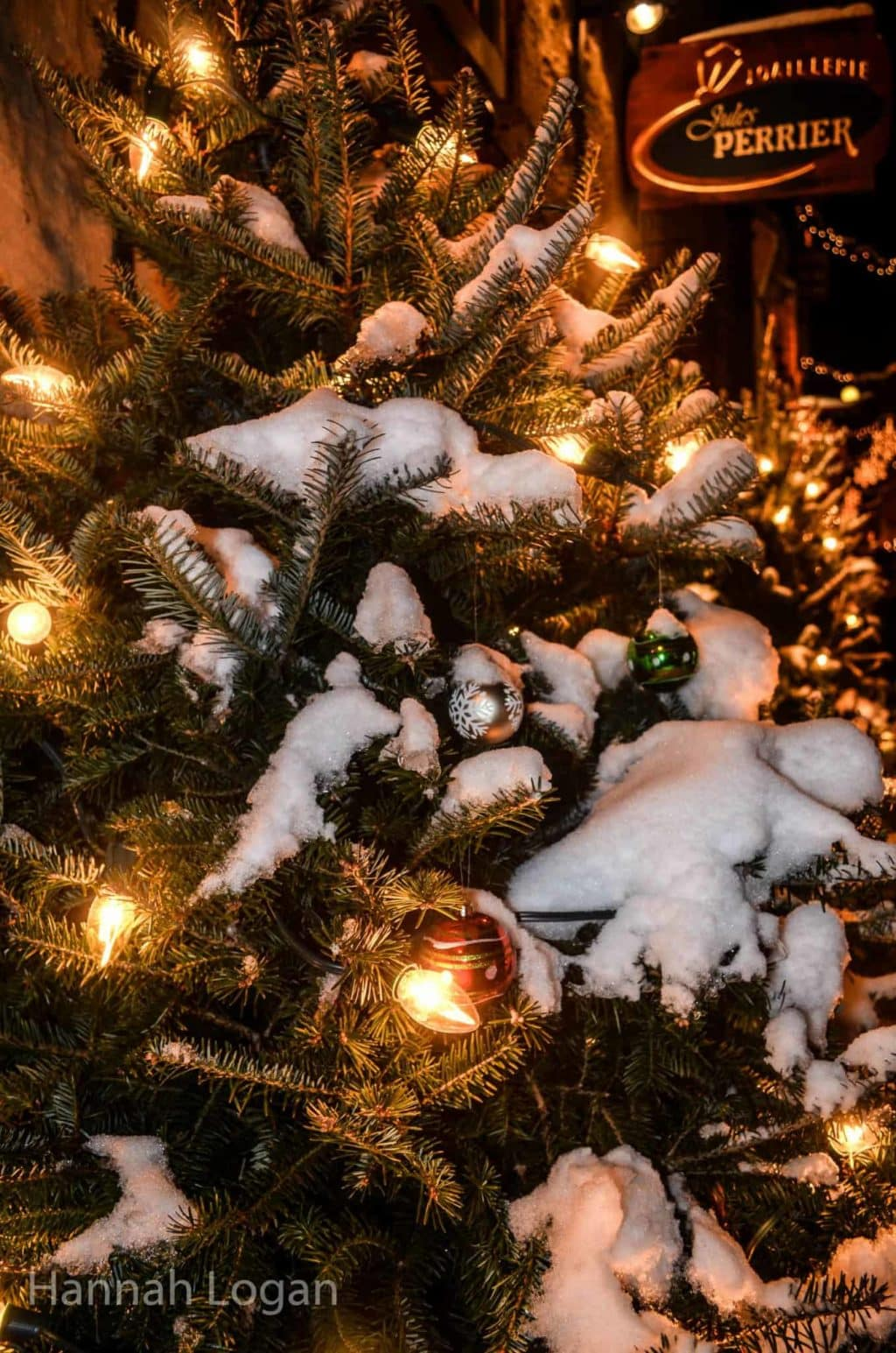a white christmas in quebec city a photo essay eat sleep snowy christmas tree outside a shop