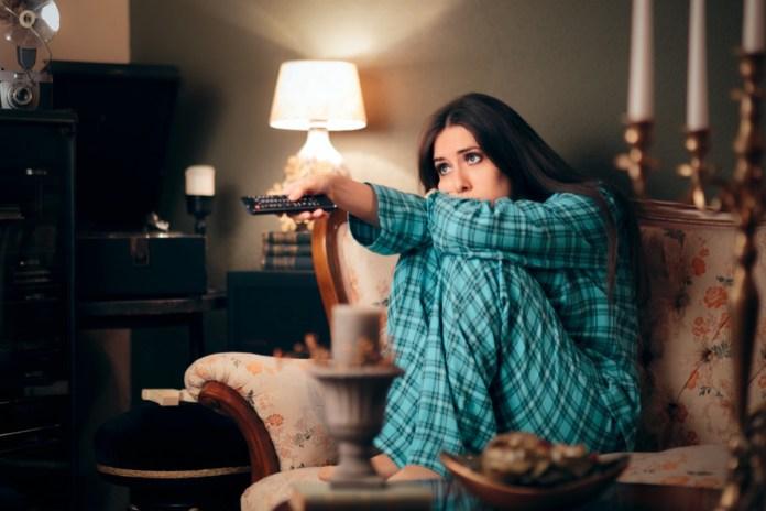 Woman Wearing Pajamas Watching TV in her Room
