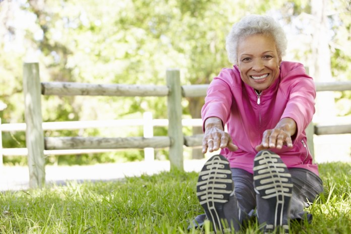 Senior African American Woman Exercising In Park