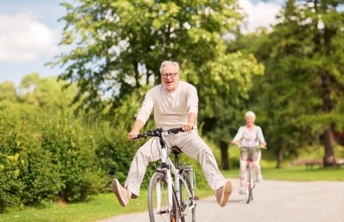 happy senior couple riding bicycles