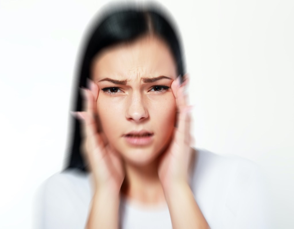 Woman over white with blurred vision and difficulty focusing