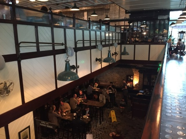 Several floors of diners at Dishoom, King's Cross, London