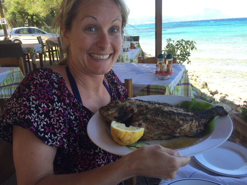 An excited Eat with Ellen with red snapper in Boukari Beach, Corfu