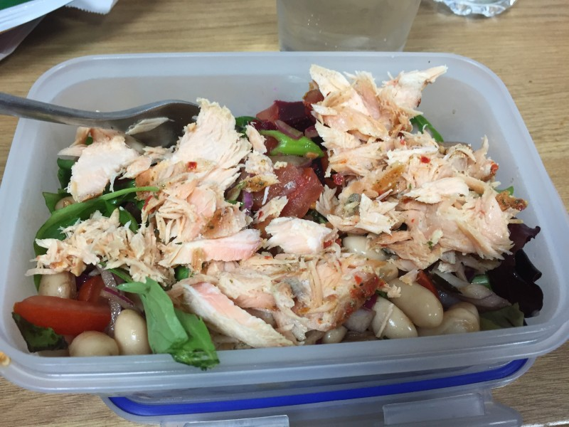 Lunchtime fish salad in a tupperware