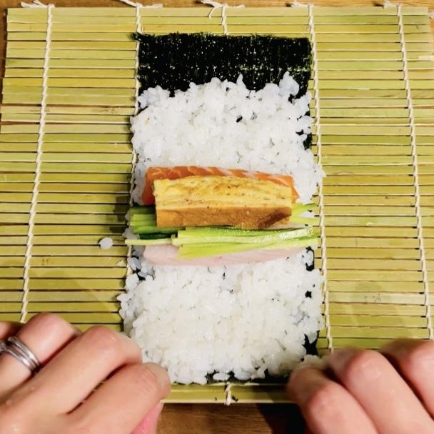 Salmon Albacore Japanese Egg Omlette Cucumbers on Sushi Rice on Nori Seaweed on Makisu - Sushi Roll 2 - EATwithOHASHI.com