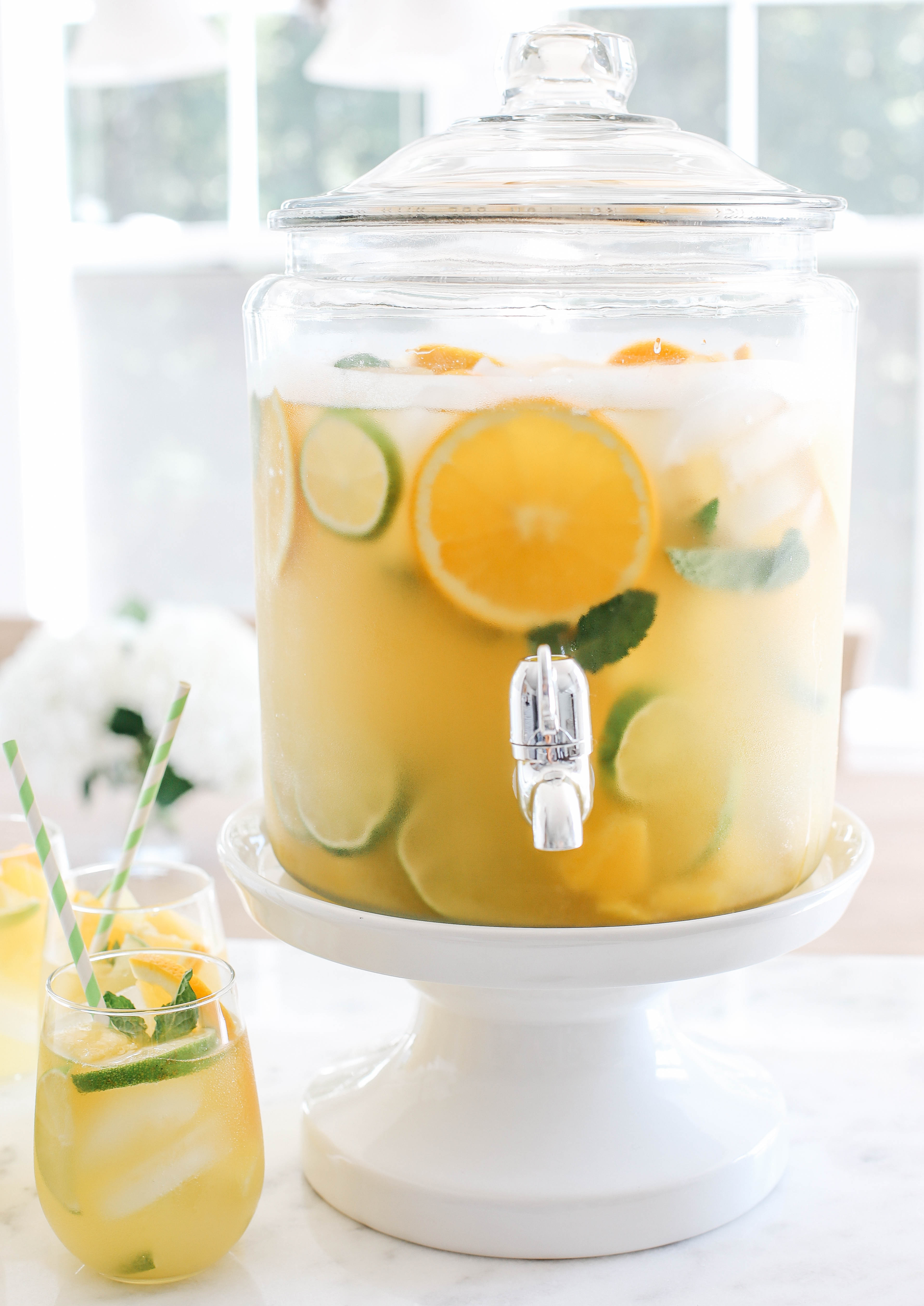 This Citrus Sangria combines all your favorite flavors of summer in one refreshing cocktail with a delicious mixture of fresh pineapple, oranges and limes all topped off with sparkling water!