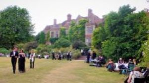 Festival Goers enjoy a picnic on the lawns. Where is the butler when you need him?