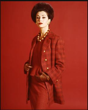 1960 model dressed in red skirt suit