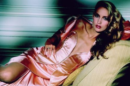 Jerry Hall in pink satin