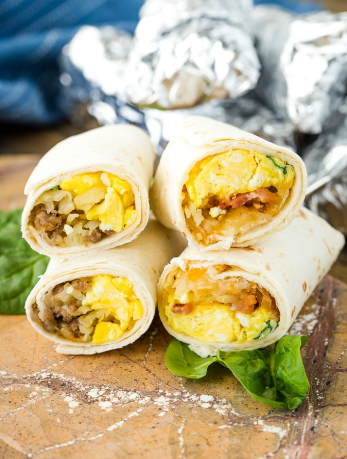 A stack of breakfast burritos