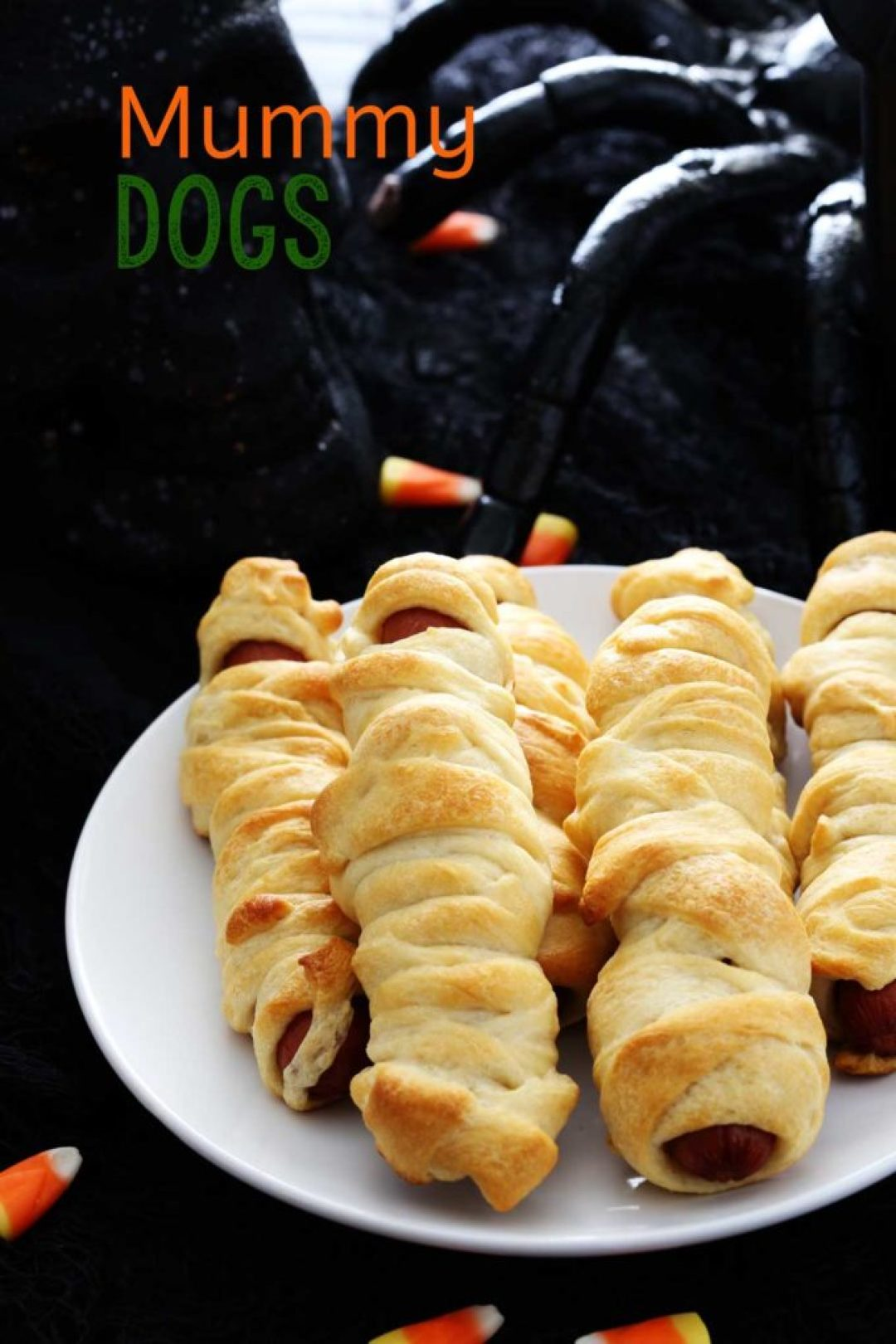 Halloween Mummy Dogs are a perfect meal for Halloween night and lots of fun for the kids! Mummy Dogs are a fun, festive, and easy meal.