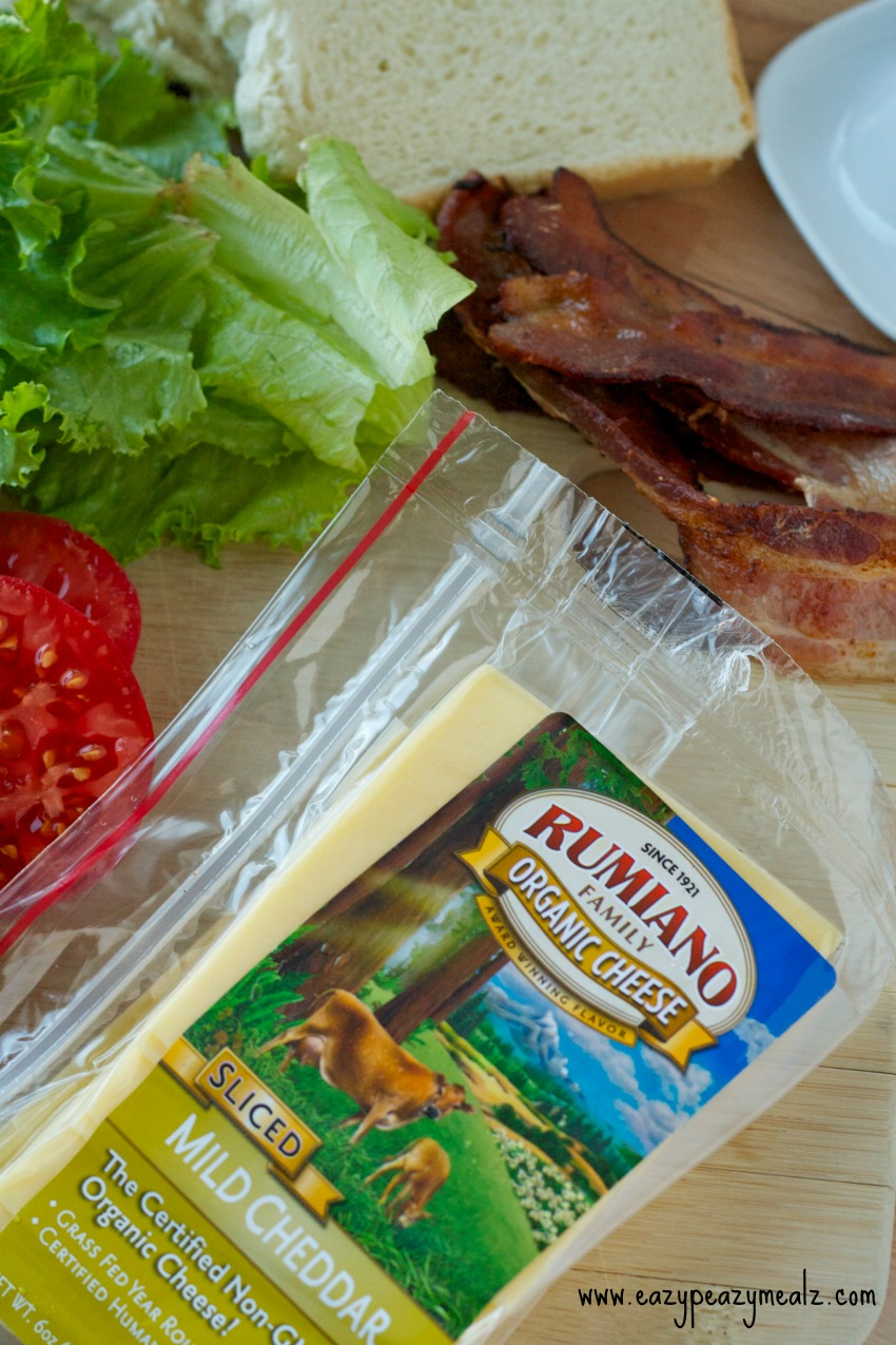 rumiano cheese with tomatoes, lettuce, bread and bacon to the side