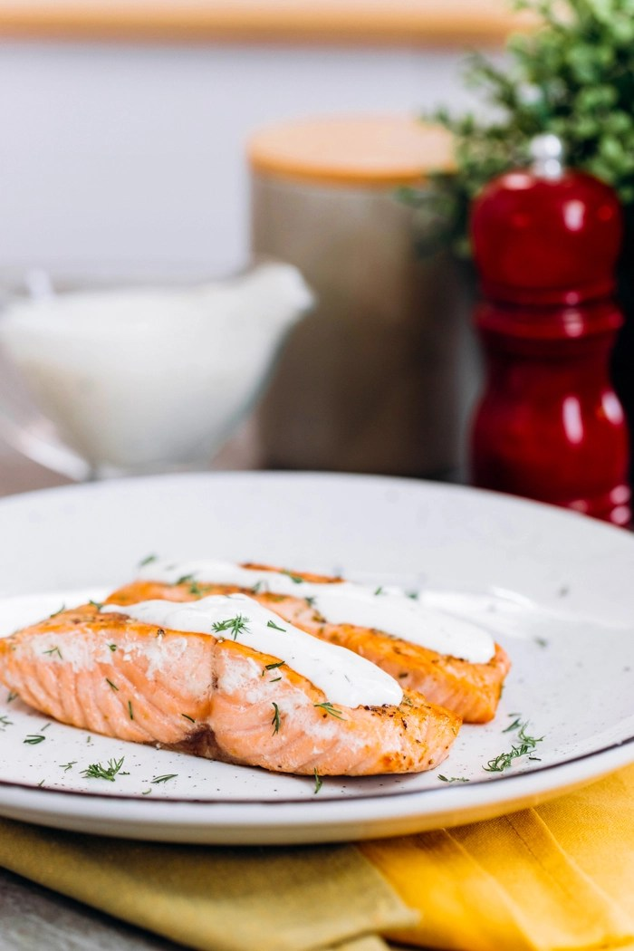 Creamy dill sauce over salmon fillets.