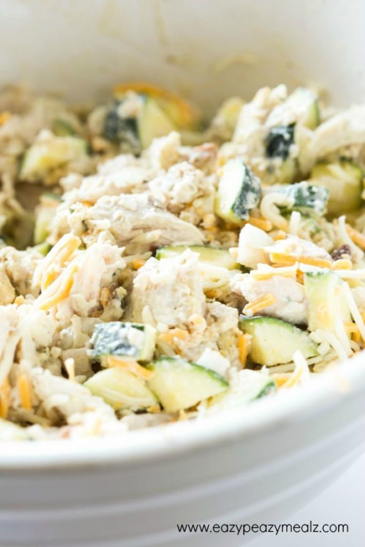 Cheesy Turkey Zucchini Casserole: casserole filling mixed in a white bowl ready to bake