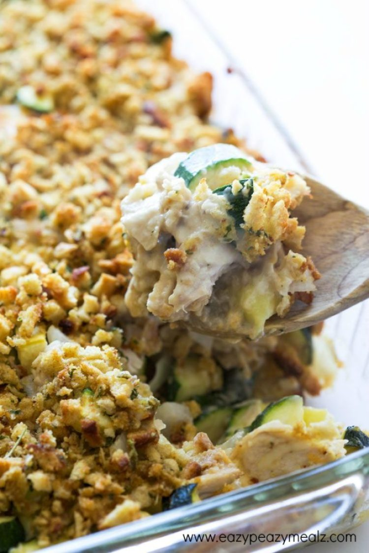 Cheesy Turkey Zucchini Casserole: Casserole in a glass dish being served by a wooden spoon